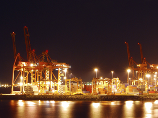 A photograph of port with lights on at night.