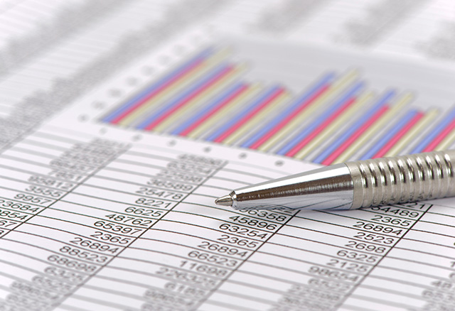 An image of a printed spreadsheet with multiple rows of data and a bar graph