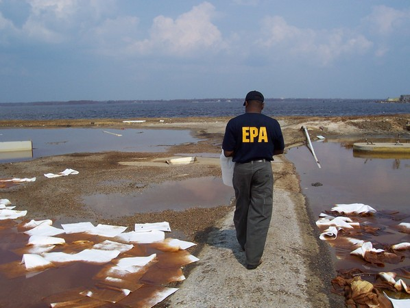 EPA employee walking toward water