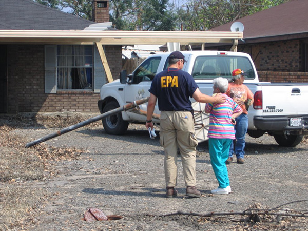 EPA employee and a woman outside of a house