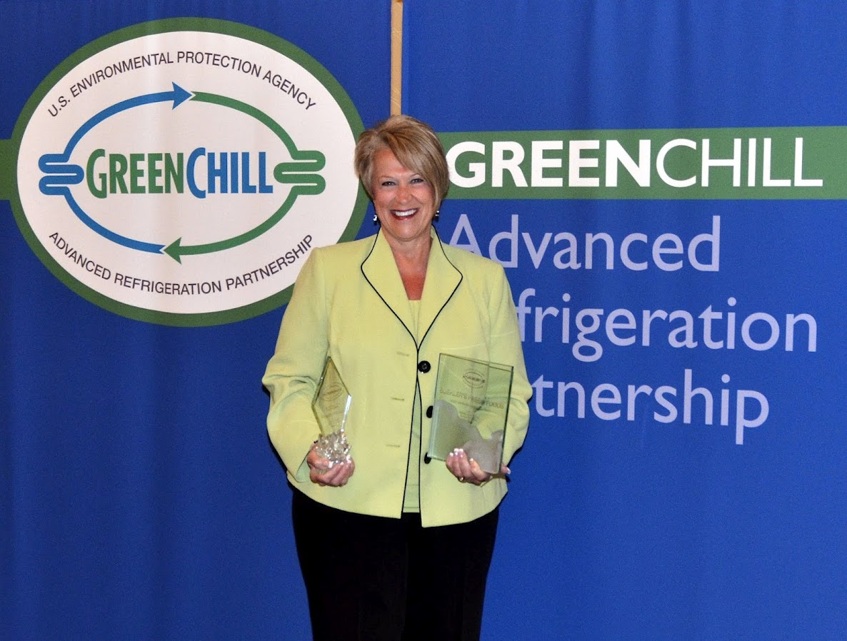 Becky Foster from Buehler's Fresh Foods accepts two awards from GreenChill for the Most Improved Emissions Rate and Goal Achievement