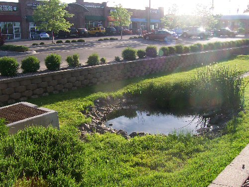 Example of a retention pond in a Denver, CO shopping center.