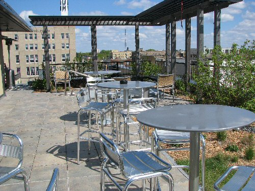 Tables and Chairs on the roof of the Hotel Donaldson's Restaurant allows guests to have a great view and enjoy benefits of the green roof.