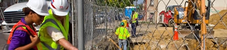 A construction site with workers in protective gear