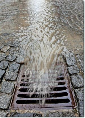 Water rushing into a stormdrain