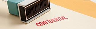 Image of the word confidential stamped on a page