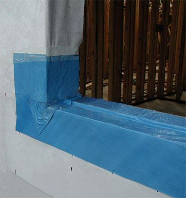 An example of window flashing, applied so that water drains to the outside