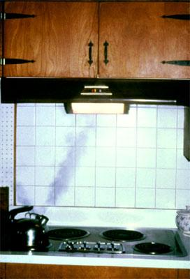 Example of an exhaust hood and fan over a stovetop in a kitchen.