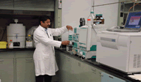 Chemist analyzing samples on liquid chromatographic/mas spectophotometer lc/ms