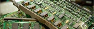 Image of a few computer mother boards stacked on top of each other