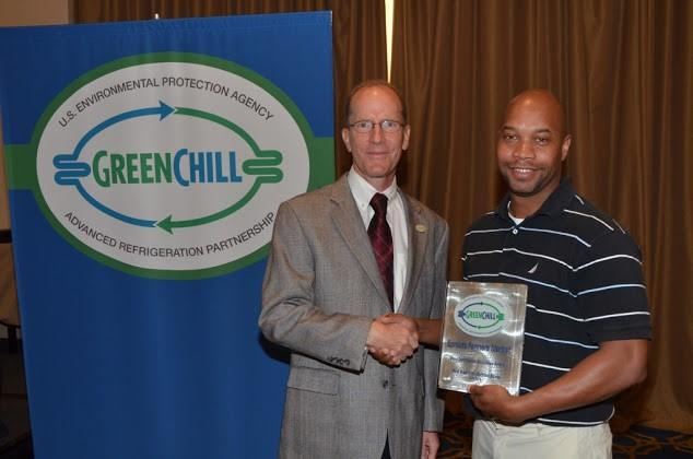 Anthony Smith of Sprouts Farmers Market accepts the Store Certification Excellence award from Tom Land of the EPA GreenChill Program.