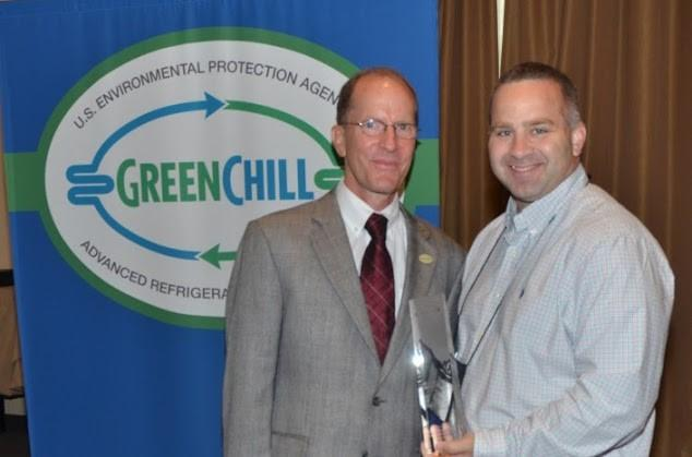 Brad Morris of Giant Eagle accepts the Best Emissions Rate award from Tom Land of the EPA GreenChill Program.