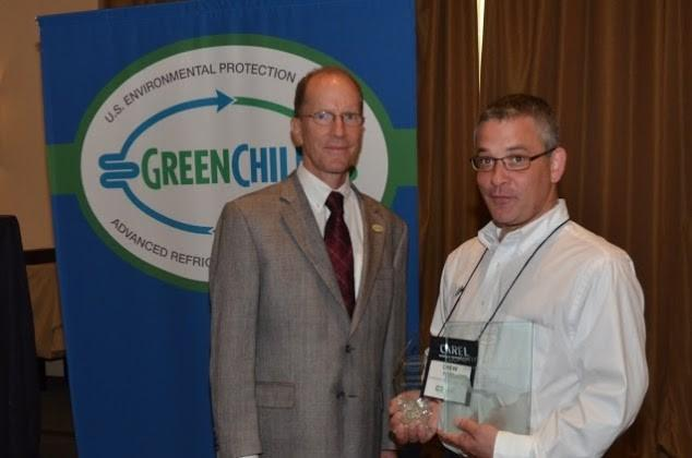 Drew Post of Dorothy Lane Market accepts Superior Goal Achievement and Most Improved Emissions Rate awards from Tom Land of the EPA GreenChill Program.