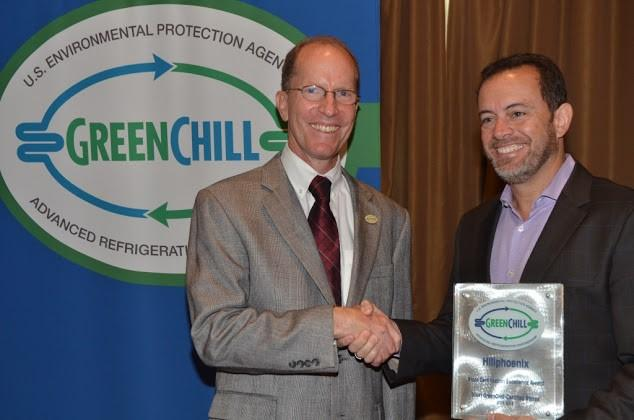 Eduardo Navarro de Andrade of Hillphoenix accepts the Store Certification Excellence award from Tom Land of the EPA GreenChill Program.