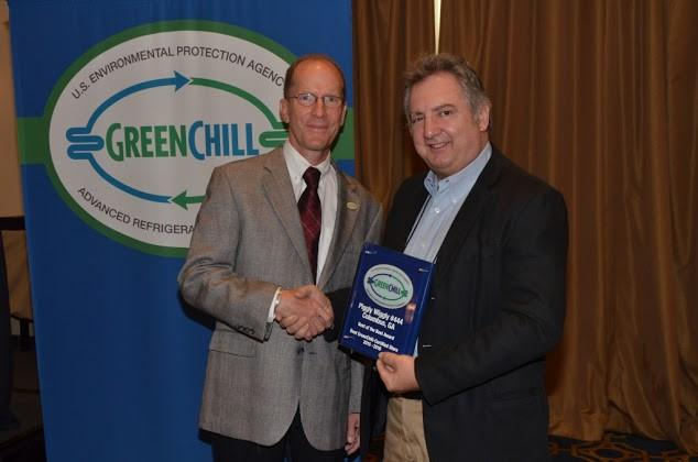Keith Milligan of Piggly Wiggly accepts the Best of the Best award for the store in Columbus, GA from Tom Land of the EPA GreenChill Program.