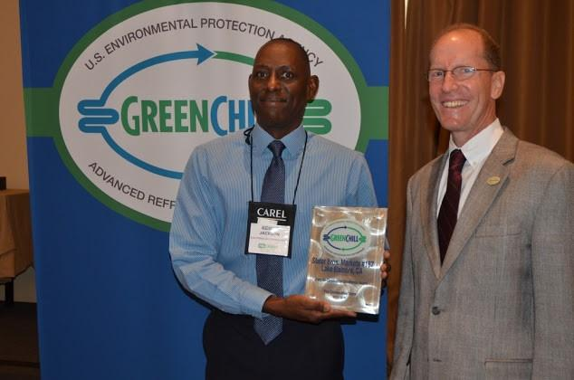 Kenneth Jackson on behalf of Stater Bros. Markets accepts one of four Store Re-Certification Excellence awards from Tom Land of the EPA GreenChill Program.