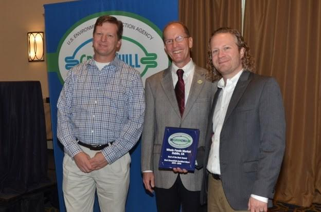 Mike Ellinger (left) and Tristam Coffin (right) of Whole Foods Market accept the Best of the Best award for their store in Dublin, CA from Tom Land of the EPA GreenChill Program.