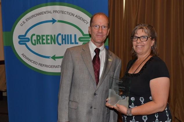 Patti Olenick of Weis Markets accepts the Most Improved Emissions Rate, Superior Goal Achievement, and Store Re-Certification Excellence awards from Tom Land of the EPA GreenChill Program.