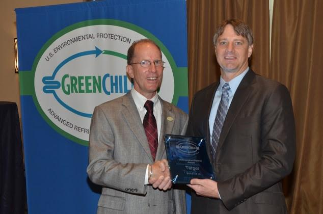 Paul Anderson of Target accepts the Distinguished Partner award from Tom Land of the EPA GreenChill Program.