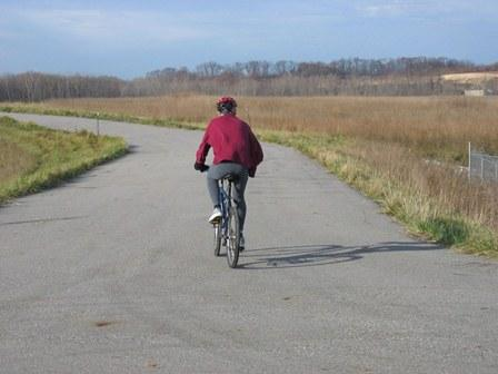 A bicyclist on the bike trail at the site