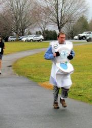 Runner in toilet costume