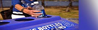 Photo of a woman recycling a plastic bottle