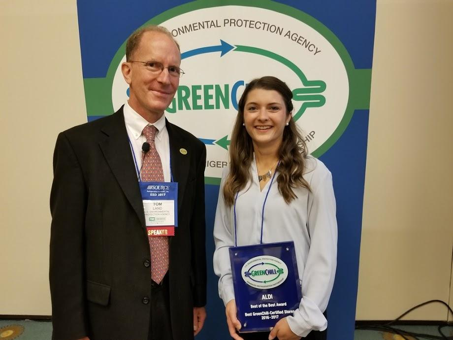 Amber Hardy accepts ALDI's Best of the Best recognition from Tom Land of the EPA GreenChill Program