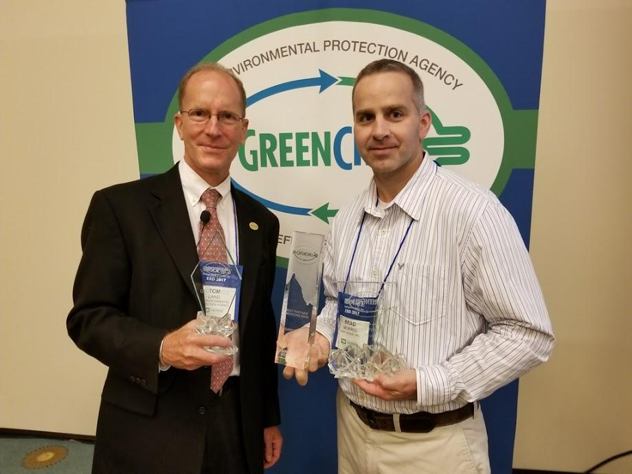 Brad Morris accepts Giant Eagle's Best Emissions Rate, Superior Goal Achievement, and Exceptional Goal Achievement recognitions from Tom Land of the EPA GreenChill Program