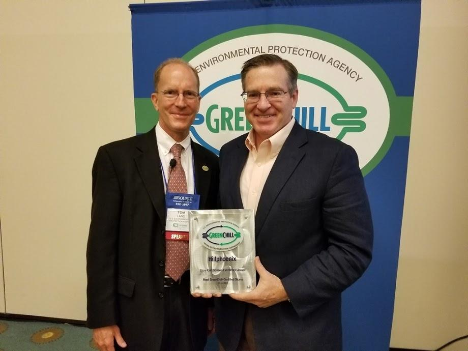 Scott Martin accepts Hillphoenix's Store Certification Excellence recognition from Tom Land of the EPA GreenChill Program
