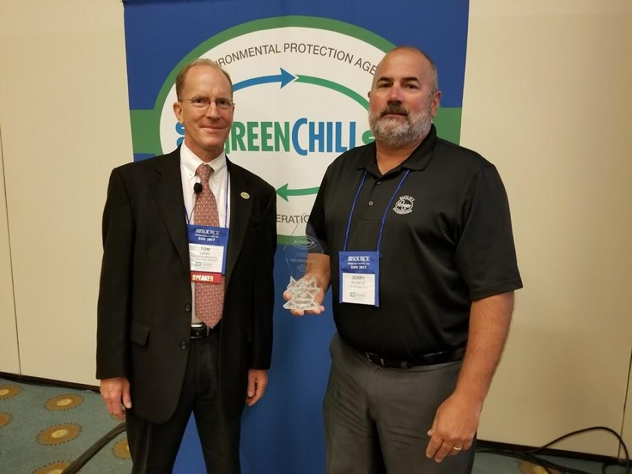Jerry Rumple accepts Kroger's Superior Goal Achievement recognition from Tom Land of the EPA GreenChill Program