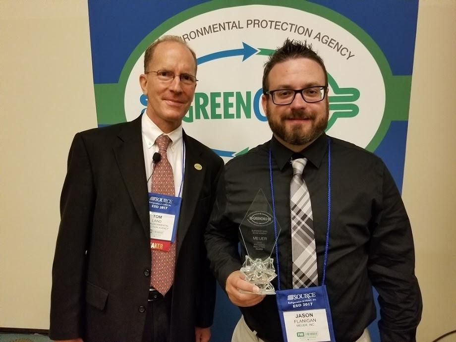 Jason Flanigan accepts Meijer's Superior Goal Achievement recognition from Tom Land of the EPA GreenChill Program