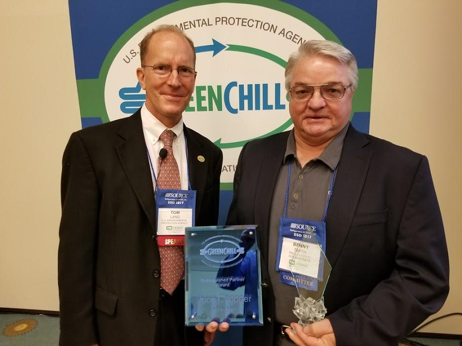 Benny Smith accepts Price Chopper's Superior Goal Achievement and Distinguished Partner recognitions from Tom Land of the EPA GreenChill Program