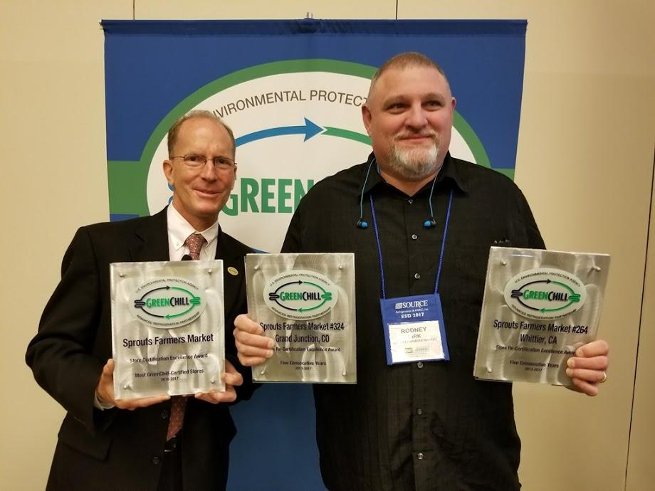 Rodney Kirk accepts Sprouts Farmers Market's Store Certification Excellence and two Store Re-Certification Excellence recognitions from Tom Land of the EPA GreenChill Program