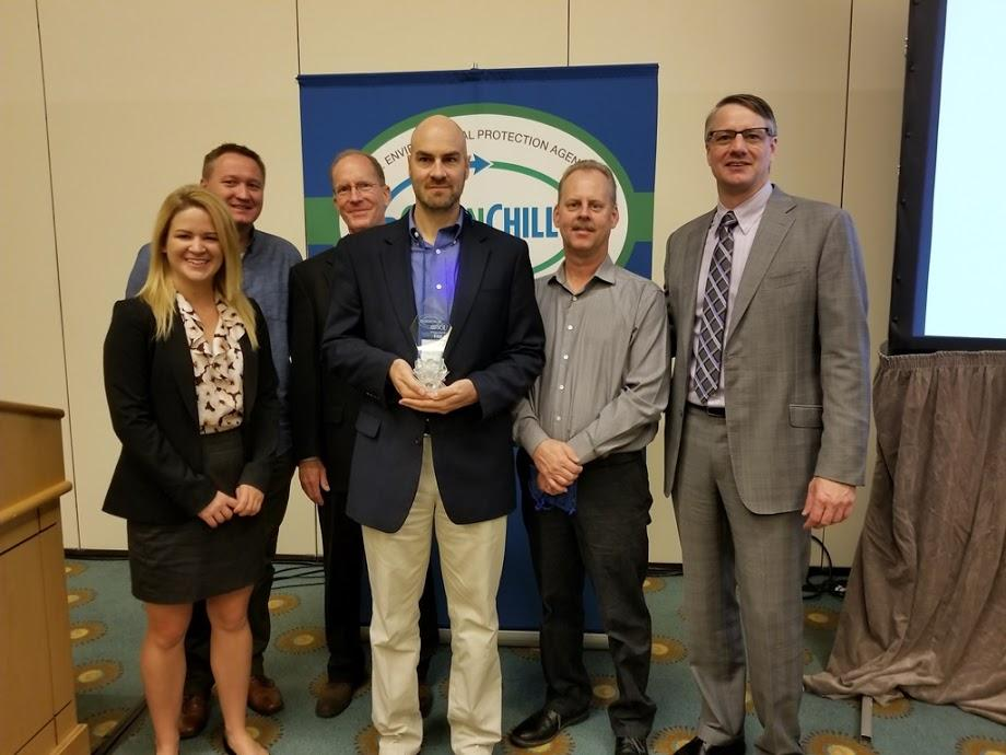 The Target team accepts their Superior Goal Achievement recognition from Tom Land of the EPA GreenChill Program