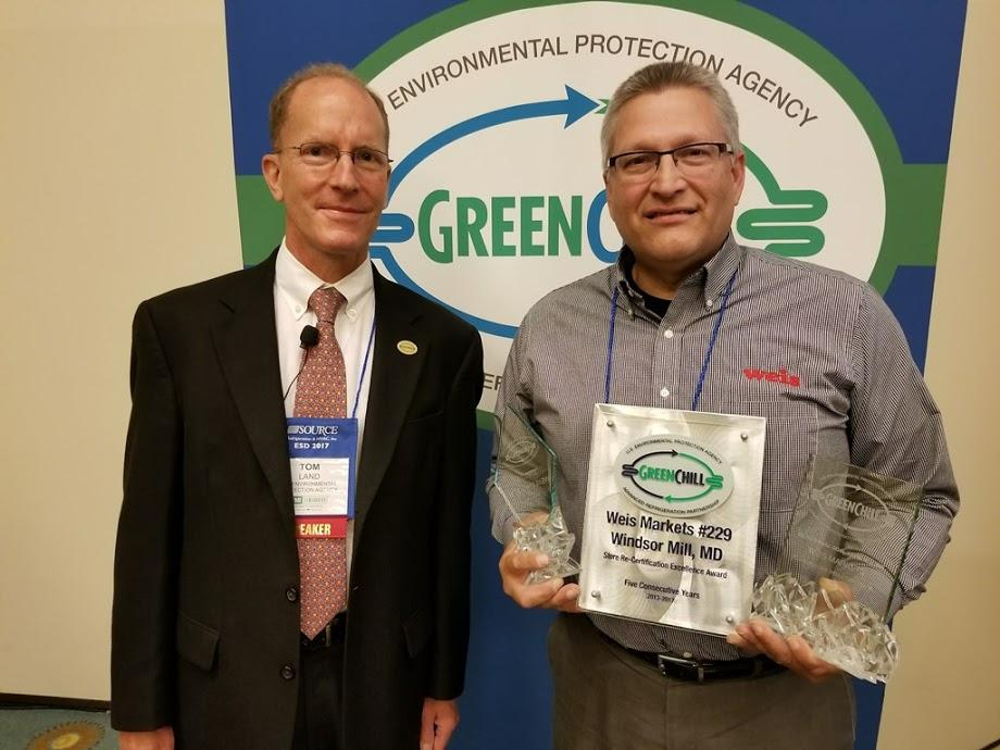 John T. Lerch accepts Weis Market's Superior Goal Achievement, Exceptional Goal Achievement, and Store Re-Certification Excellence recognitions from Tom Land of the EPA GreenChill Program