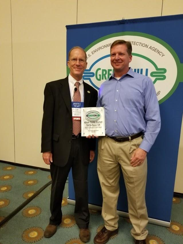 Mike Ellinger accepts Whole Foods Market's Store Re-Certification Excellence recognition from Tom Land of the EPA GreenChill Program