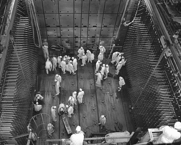 Workers laying graphite blocks in C Reactor in 1952.
