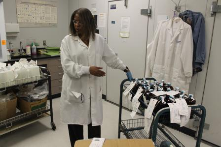 Photo of Scientist receiving laboratory samples for analysis.