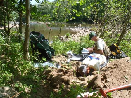 Crew members sampling soil at a site during NWCA 2011