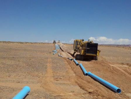 Pipes laid out across land to be used to transport water