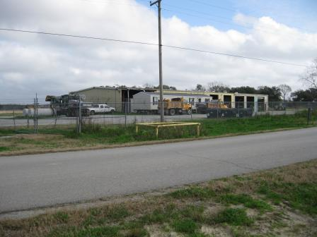 The fenced area north of the limestone road is being used by the Vermilion Parish Police Jury as a vehicle maintenance area