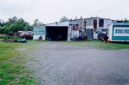 A photograph of Pinette's vehicle salvage yard garage