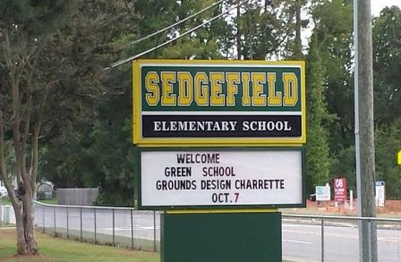 Sign announces special forum – the Green School Grounds Design Charrette.
