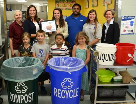 Students and staff from Shawnee mission school district behind compost, recycle, liquids and silverware bins