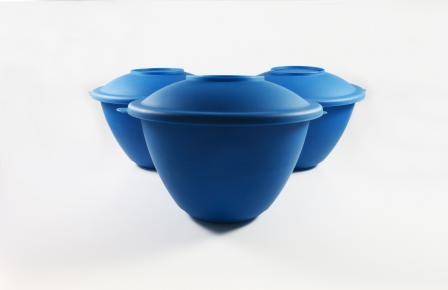 This picture is of three blue salad bowls. The bowls form a triangle, with the point of the triangle in the center and foreground of the picture, and the other two bowls behind, adjacent to each other.