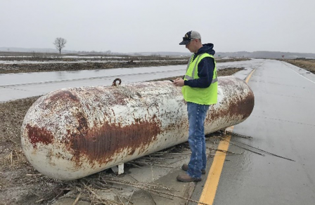 image of orphaned tank in 2019 Iowa flood zone
