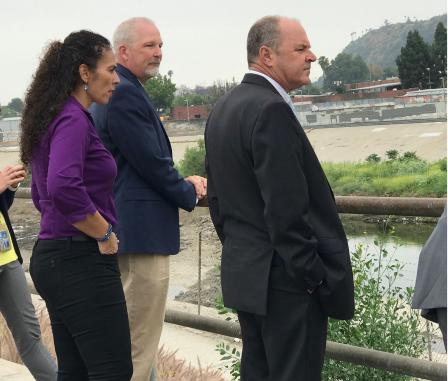 EPA Pacific Southwest Regional Administrator Mike Stoker (in suit) and others tour Taylor Yard River Park.