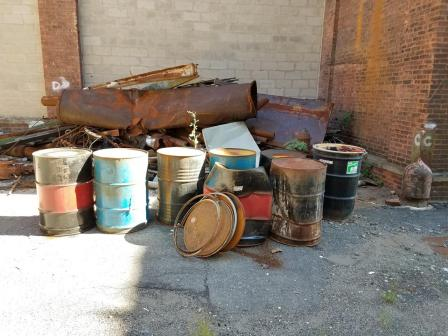 Rusted drums at the Vo-Toys site.