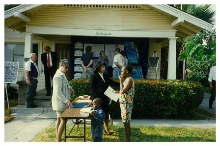 People outside of a neighborhood open house in 1996
